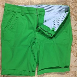 A pair of JCP green shorts and the size is 6P